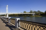 The suspended pedestrian overpass through the Ural river